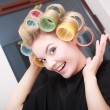 Woman in beauty salon, blond girl hair curlers rollers by hairdresser. Hairstyle. — Stok fotoğraf