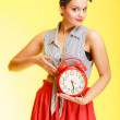 Portrait of fashionable pin-up girl sexy woman holding red clock — Stock Photo