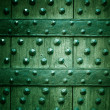 Old wooden background with metal rivets green color — Stock Photo