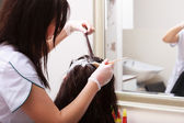 Hairdressing beauty salon. Woman dying hair. Hairstyle. — Stock Photo
