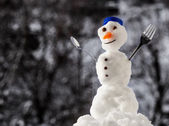 Little happy christmas snowman with fork outdoor. Winter season. — Stock Photo