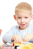 Happy childhood. Boy child kid eating peeled apple fruit. At home. — Stock Photo
