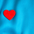 Stock Photo: Valentine's day background. Red heart on blue folds cloth