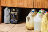 Plastic containers oil can grunge bottles and tanks in car service — Stock Photo