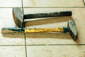 Two old sledge hammers hand tools in mechanic garage car service — Stock Photo