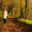 Woman walking relaxing in autumn park. Co.Cork, Ireland. — Stock Photo #40267417
