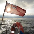 British maritime ensign flag boat and stormy sky — Stock Photo #40267781