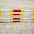 Stock Photo: Yellow red white obstacle for jumping horses. Riding competition.