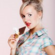 Portrait of young woman sexy girl eating chocolate on pink — Stock Photo #40268655