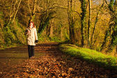 Woman walking relaxing in autumn park. Co.Cork, Ireland. — Stock Photo
