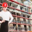Female engineer woman in red safety helmet on construction site — Stock Photo