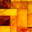 Closeup of golden amber mosaic as background or texture. Gem. — Stock Photo