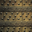 Old wooden background with metal rivets — Stock Photo