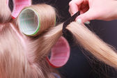 Female blond hair head curlers rollers hairdresser beauty salon — Stock Photo