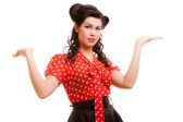 Retro pin-up girl young woman shrugging her sholders isolated — Stock Photo