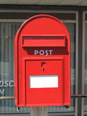 Red postbox letterbox on the street — Stock Photo