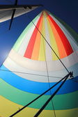 The wind has filled colorful spinnaker sail — Stockfoto