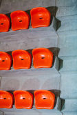 Closeup of red sport stadium seats. Empty stand. Team sport supporter — ストック写真