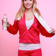Fitness woman sport girl with towel and water bottle on pink — Stock Photo #40441559