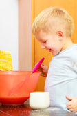 Boy kid baking cake. Child beating dough with wire whisk. Kitchen. — Stock Photo