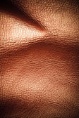 Texture of folds vivid brown skin leather background — Stock Photo