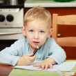 Blond boy child kid drawing with marker on piece of paper. At home. — Stock Photo #40566419