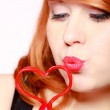 Redhaired girl holding red heart love blowing kiss. Valentines day. — Photo
