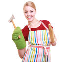 Happy housewife apron oven mitten holds kitchen utensil isolated — Stock Photo