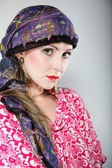 Portrait beautiful girl woman in a headscarf — Stock Photo