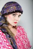 Portrait beautiful girl woman in a headscarf — Stock Photo