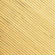 Bamboo mat surface pattern diagonal background texture — Stock Photo #40646411