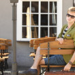 Young handsome man with suitcase waits on bench — Stock Photo #40740105