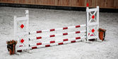 Red white obstacle for jumping horses. Riding competition. — Stock Photo