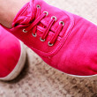 Closeup of casual vibrant pink sneakers shoes boots on female feet — Stock Photo #40821437