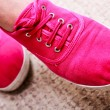 Closeup of casual vibrant pink sneakers shoes boots on female feet — Stock fotografie #40821437