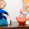 Boys kids baking cake. Children beating dough with wire whisk. — Stock Photo #40877203