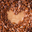 Stock Photo: Healthy diet. Flax seeds linseed border on wooden background
