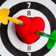 Black white target with two darts in heart love symbol as bullseye — Stock Photo #41170347