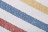 Closeup of colorful striped textile as background or texture — Stock Photo