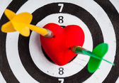 Black white target with two darts in heart love symbol as bullseye — Foto de Stock