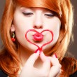 Redhaired girl holding red heart love blowing kiss. Valentines day. — Foto de Stock