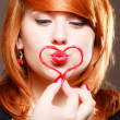 Redhaired girl holding red heart love blowing kiss. Valentines day. — Stok fotoğraf