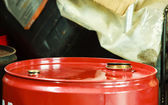 Red oil barrels in mechanic garage car service or shop — Stock Photo