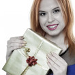 Young happy red haired woman with a gift box isolated — Stock Photo #41525261
