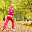 Stock Photo: Woman running in autumn forest. Female runner training.