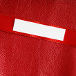 Piece scrap paper blank copy space on red leather background — Stock Photo #41589637