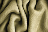 Brown background abstract cloth wavy folds of textile texture — Stock Photo