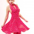 Beautiful pinup girl in blond wig and retro red dress dancing. Party. — Stock Photo #41894077