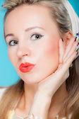 Portrait beautiful woman pinup girl retro style blowing a kiss - flirty on blue — Stock Photo