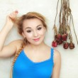 Blond woman teenage girl showing her damaged dry hair — Stock Photo